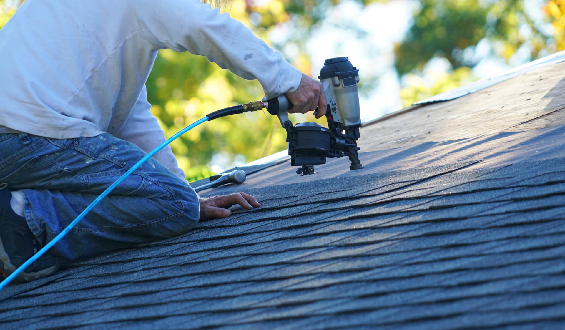 Roofing Contractor In Dallas Completing Roof Replacement